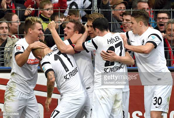 Players of Freiburg celebrate opening goal of Jonathan Schmid during the Bundesliga match between SC Freiburg and FC Augsburg at SchwarzwaldStadium...