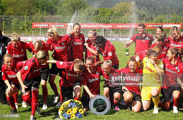 Players of Freiburg celebrate promotion to the Bundesliga after winning the Second Women's Bundesliga South match between SC Freiburg and FCR...