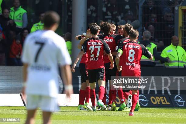 Players of Freiburg celebrate the goal of Nils Petersen of Freiburg during the Bundesliga match between SC Freiburg and Bayer 04 Leverkusen at...