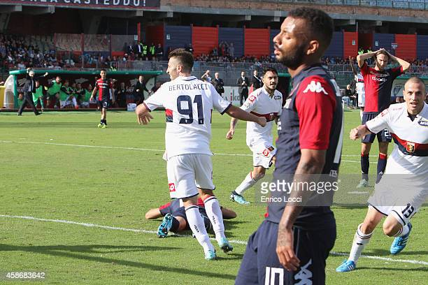 Players of Genoa celebrate an own goal by Luca Rossettini of Cagliari during the Serie A match between Cagliari Calcio and Genoa CFC at Stadio...