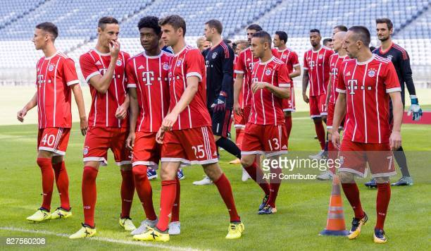 Players of German first division Bundesliga football club FC Bayern Munich arrive to pose for a team photo on August 8 2017 in Munich southern...