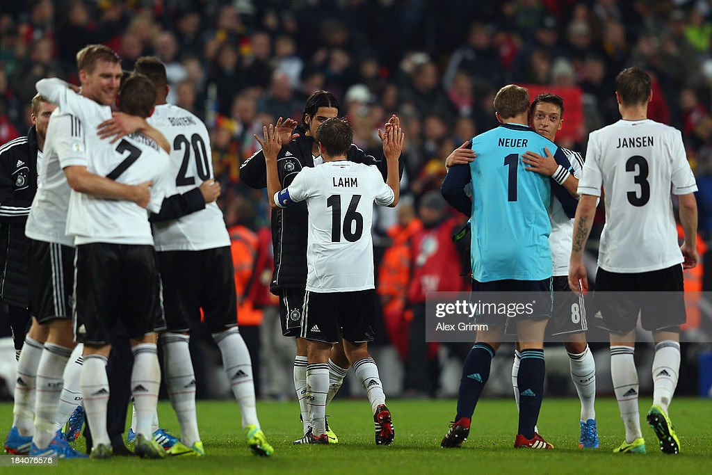 Players of Germany celebrate after the FIFA 2014 World Cup Group C qualifiying match between Germany and Republic of Ireland at RheinEnergieStadion on October 11, 2013 in Cologne, Germany.