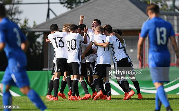 Players of Germany celebrate after the opening goal during the Under 17 four nations tournament match between U17 Germany and U17 Italy at...