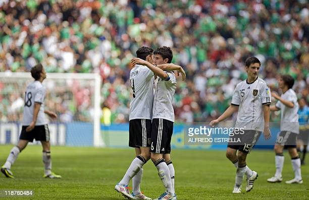 Players of Germany celebrate after winning in their U17 World Cup football match for the third place against Brazil at the Azteca Stadium in Mexico...