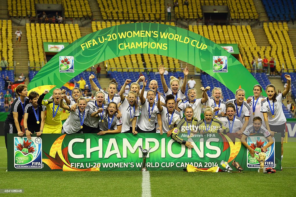 Players of Germany celebrate after winning the FIFA U-20 Women's World Cup Canada 2014 final match between Nigeria and Germany at Olympic Stadium on August 24, 2014 in Montreal, Canada.