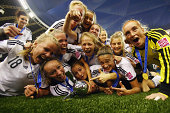 Players of Germany celebrate after winning the FIFA U20 Women's World Cup Canada 2014 final match between Nigeria and Germany at Olympic Stadium on...