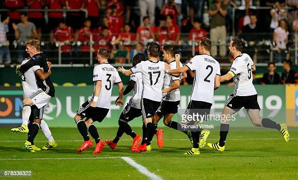 Players of Germany celebrate after winning the penalty shoot during the UEFA Under19 European Championship match between U19 Germany and U19...