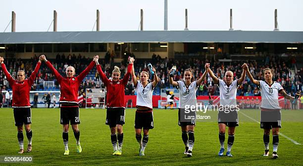 Players of Germany celebrate after winning the UEFA Women's Euro 2017 qualifier between Germany and Croatia at Osnatel Arena on April 12 2016 in...