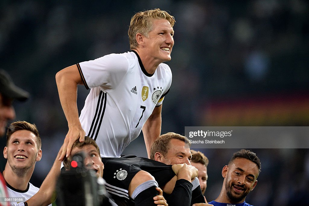 Players of Germany celebrate Bastian Schweinsteiger after the international friendly match between Germany and Finland at Borussia-Park on August 31, 2016 in Moenchengladbach, Germany.