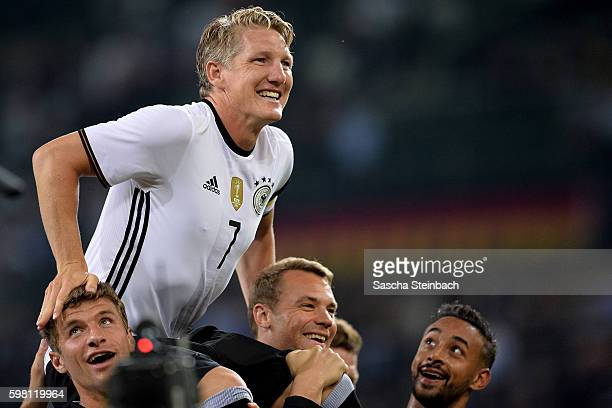 Players of Germany celebrate Bastian Schweinsteiger after the international friendly match between Germany and Finland at BorussiaPark on August 31...