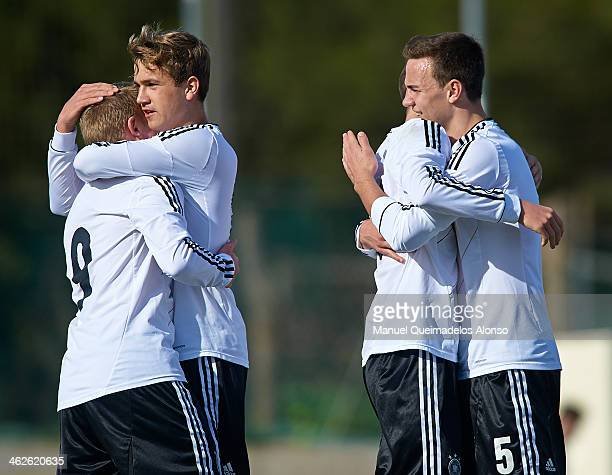 Players of Germany celebrate during the friendly match between U18 FC Barcelona and U17 Germany at la Manga Club on January 14 2014 in La Manga Spain