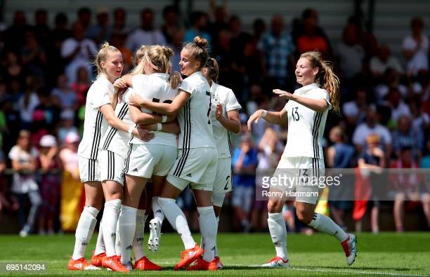 Players of Germany celebrate their team's opening goal during the U19 women's elite round match between Poland and Germany at Stadion Sandersdorf on...