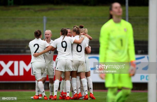 Players of Germany celebrate their team's second goal during the U19 women's elite round match between Germany and Switzerland at Friedensstadion on...