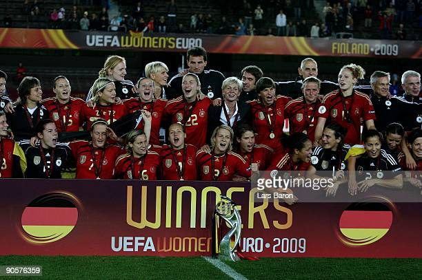 Players of Germany celebrate their victory winning the UEFA Women's Euro 2009 Final match between England and Germany at the Helsinki Olympic Stadium...