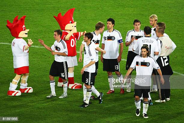 Players of Germany celebrate victory with the official mascots Trix and Flix after the UEFA EURO 2008 Group B match between Austria and Germany at...