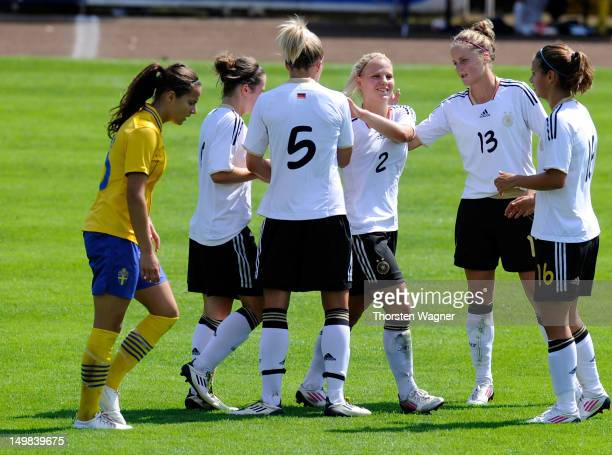 Players of Germany celebrates after Nicole Rolser is scoring her teams seventh goal during the women's U20 international friendly match between...