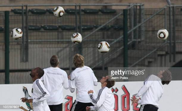 Players of Germany control the ball during a training session at Super stadium on June 22 2010 in Pretoria South Africa