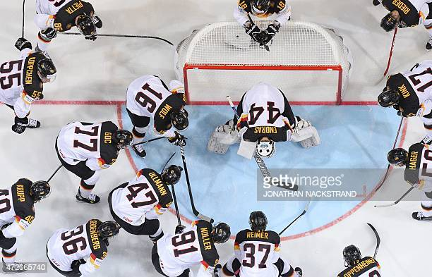 Players of Germany gather ahead of the group A preliminary round ice hockey match Canada vs Germany of the IIHF International Ice Hockey World...