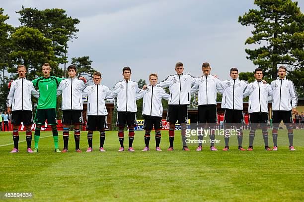 Players of Germany line up during the national anthem prior to the TOTO Cup match between U17 Germany and U17 Switzerland on August 19 2014 in...