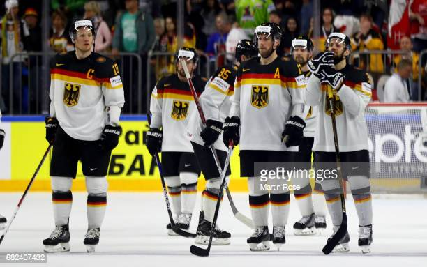 Players of Germany look dejected after the 2017 IIHF Ice Hockey World Championship game between Denmark and Germany at Lanxess Arena on May 12 2017...
