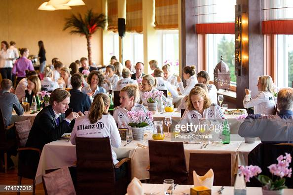 Players of Germany speak with sponsors during a meet and greet sponsors barbecue at the Germany women's training camp on May 21 2015 in Wollerau...