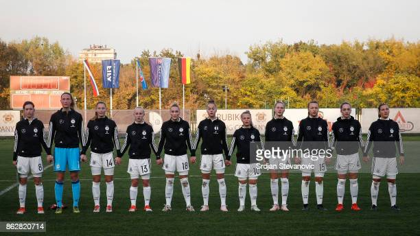 Players of Germany U19 Women's team sing their national anthem prior the international friendly match between U19 Women's Serbia and U19 Women's...