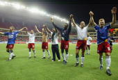 Players of Germany's Hamburg HSV wave to Chinese soccer fans after the friendly match between Germany`s Hamburg HSV and Shanghai Shenhua on May 26...