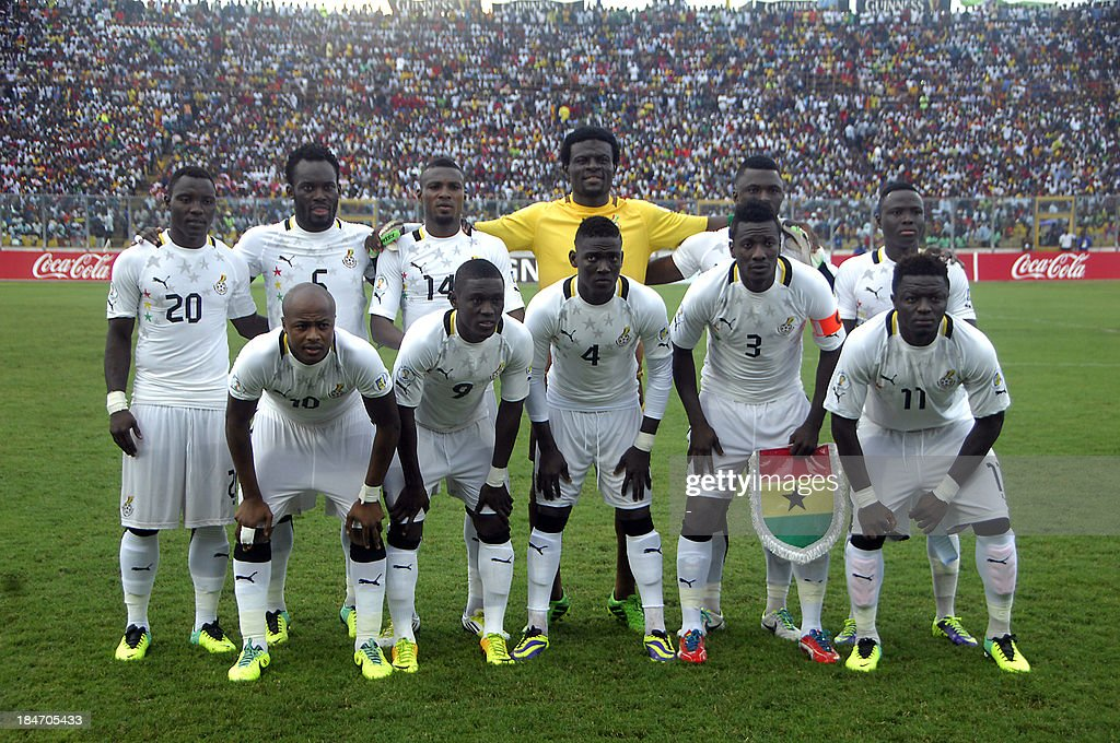 Players of Ghana's national football team before the start of the 2014 World Cup qualifying football match between Ghana and Egypt on October 15,2013 at the Babayara Sports Stadium in Kumasi. (From L - back row) Kwadwo Asamoah, Michael Essien, Jerry Akaminko, goalkeeper Abdul Fatawu Dauda, Rashid Sumaila and Samuel Inkoom; (from L- 2nd row) Andre Ayew, Abdul Majeed Waris, Daniel Opare, Asamoah Gyan and Sulley Muntari. AFP PHOTO