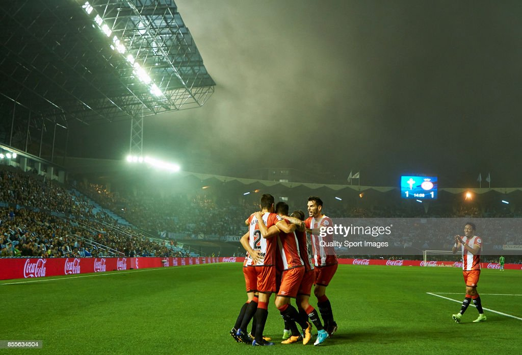 Players of Girona FC celebrate their second goal during the La Liga match between Celta de Vigo and Girona at Balaidos Stadium on September 29, 2017 in Vigo, Spain.