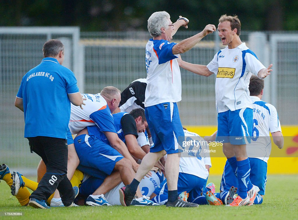 Players of Goslar celebrate during the Regionalliga North match between BV Cloppenburg and Goslarer SC at stadium Cloppenburg on August 2, 2013 in Cloppenburg, Germany.