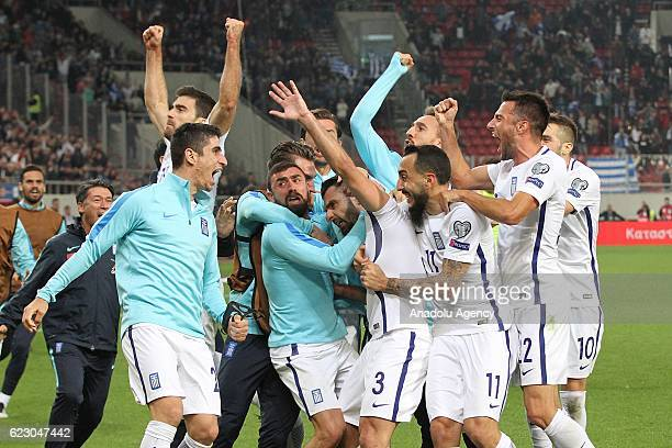 Players of Greece celebrate after scoring a goal during the 2018 World Cup qualifying Group H football match between Greece and Bosnia and...