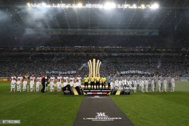 Players of Gremio and Lanus line up for the National Anthems ahead of the first leg match between Gremio and Lanus as part of Copa Bridgestone...