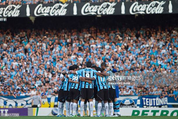 Players of Gremio celebrate a goal during a match between Grêmio and Ponte Preta as part of the Brazilian Championship Serie A at Olímpico stadium on...
