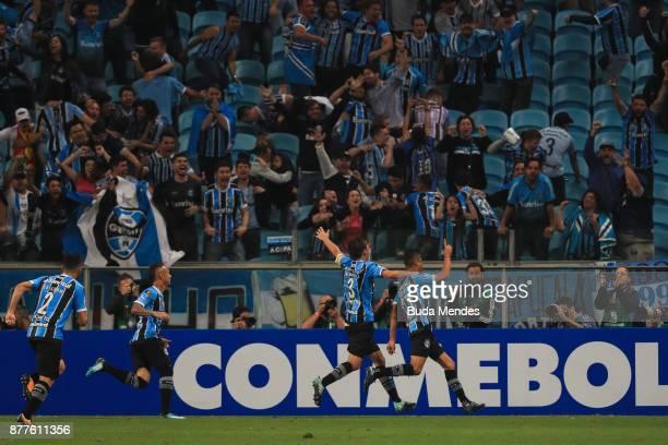 Players of Gremio celebrate a scored goal against Lanus during a first leg match between Gremio and Lanus as part of Copa Bridgestone Libertadores...