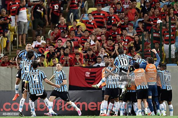 Players of Gremio celebrate a scored goal during a match between Flamengo and Gremio as part of Brasileirao Series A 2014 at Maracana Stadium on...