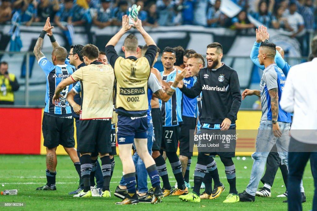 Players of Gremio celebrate after winning against Barcelona de Guayaquil, part of Copa Bridgestone Libertadores 2017 Semi-Finals, at Arena do Gremio on November 1, 2017, in Porto Alegre, Brazil.
