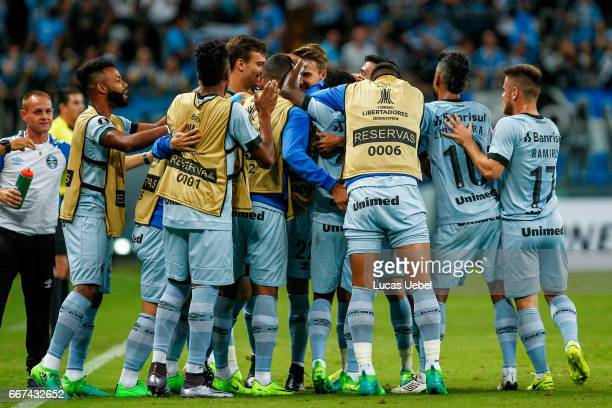 Players of Gremio celebrate their first goal during the match Gremio v Deportes Iquique as part of Copa Bridgestone Libertadores 2017 at Arena do...