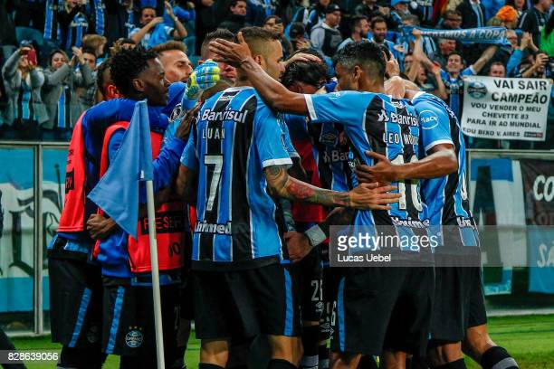 Players of Gremio celebrate their second goal during the second leg match Gremio v Godoy Cruz as part of round of 16 of Copa CONMEBOL Libertadores...