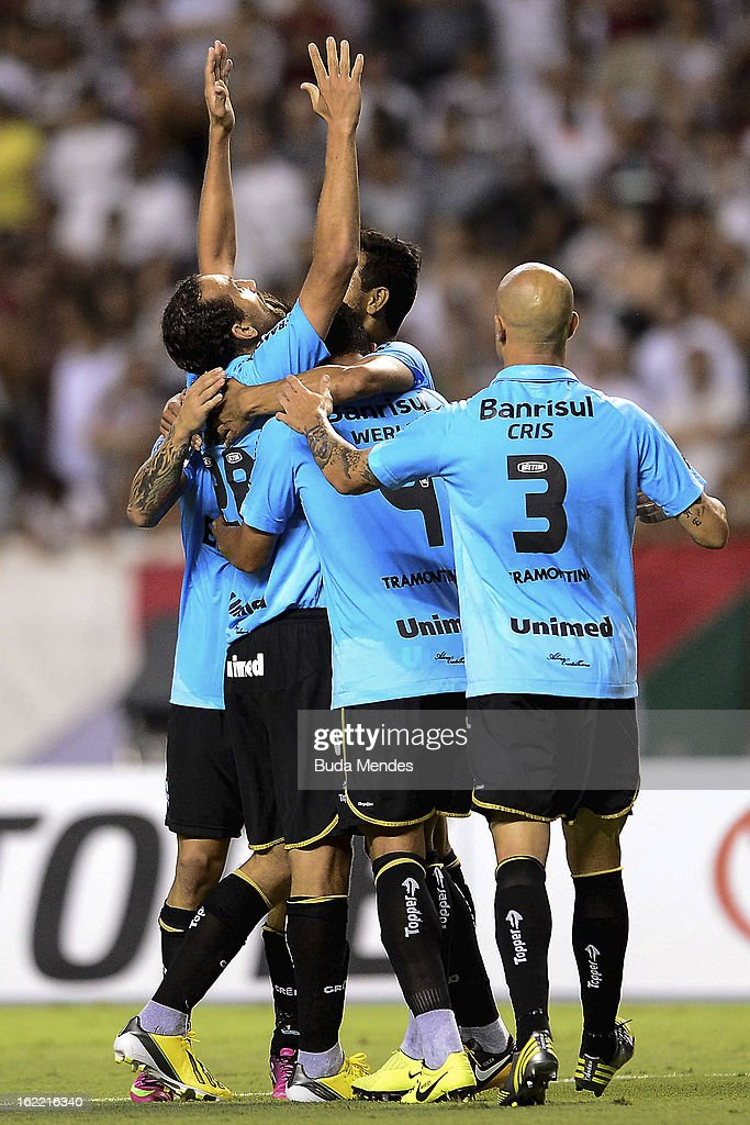 Players of Gremio celebrates a scored goal of Barcos during a match between Fluminense and Gremio as part of the Copa Libertadores 2013 at Joao...