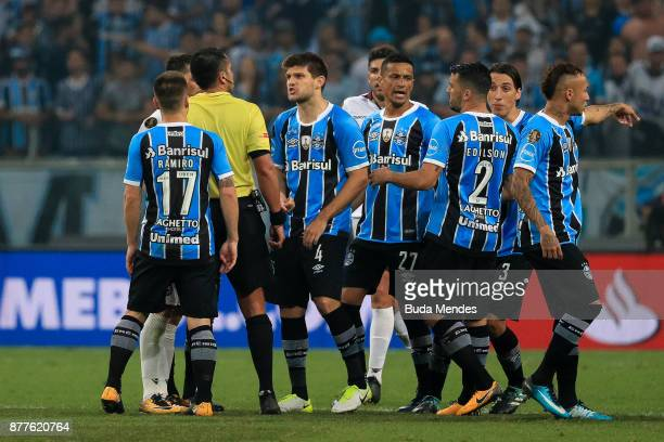 Players of Gremio reacts with the referee after the first leg match between Gremio and Lanus as part of Copa Bridgestone Libertadores 2017 Final at...