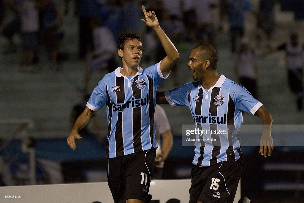 Players of Grêmio celebrate a goal during the match between Grêmio (Brazil) and Millonarios (Colombia) as part of the eighth stage of Copa Sudamericana 2012 at Olímpico stadium on October 30, 2012 in Porto Alegre, Brazil.