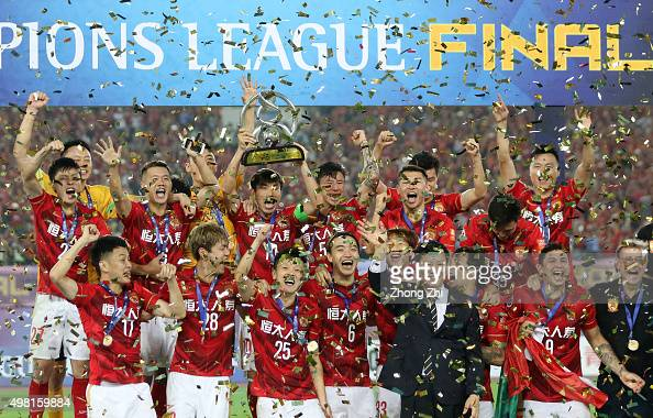 Players of Guangzhou Evergrande celebrate with trophy after winning the Asian Champions League Final 2nd leg Match between Guangzhou Evergrande and...