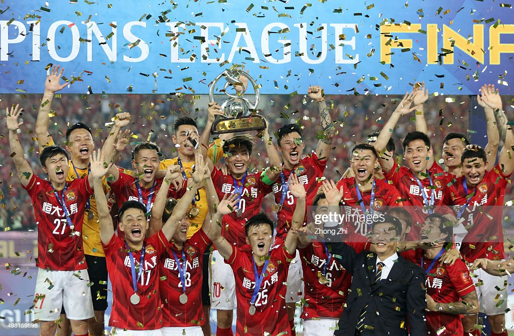 Players of Guangzhou Evergrande celebrate with trophy after winning the Asian Champions League Final 2nd leg Match between Guangzhou Evergrande and Al Ahli at Tianhe Sports Center on November 21, 2015 in Guangzhou, China.
