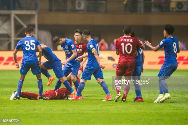 Players of Guangzhou RF argue with Oscar of Shanghai SIPG during the 13th round match of 2017 Chinese Football Association Super League between...