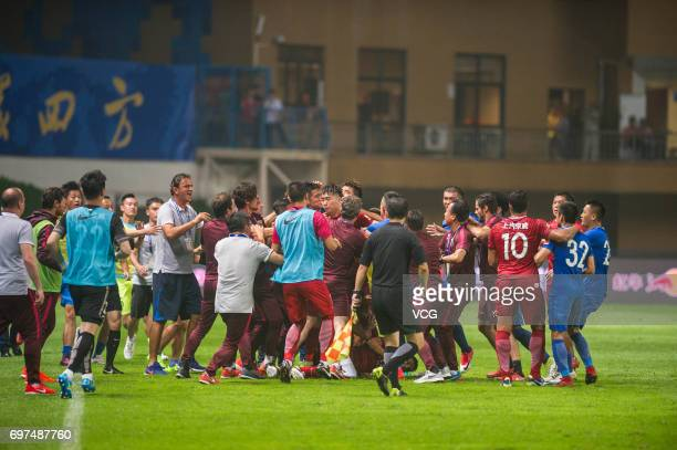 Players of Guangzhou RF argue with Players of Shanghai SIPG as Shanghai's Oscar lies on the ground during the 13th round match of 2017 Chinese...