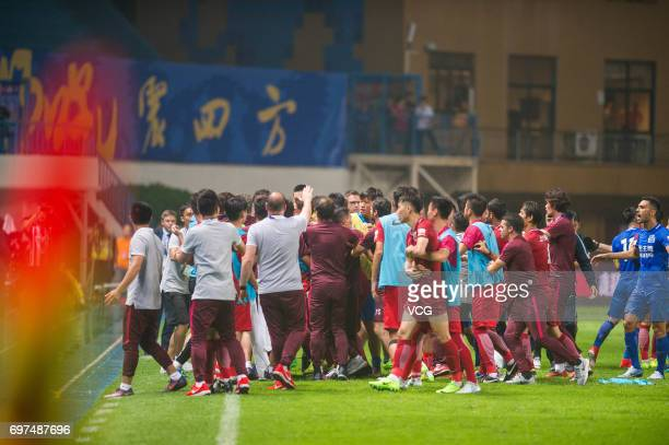 Players of Guangzhou RF argue with Players of Shanghai SIPG during the 13th round match of 2017 Chinese Football Association Super League between...