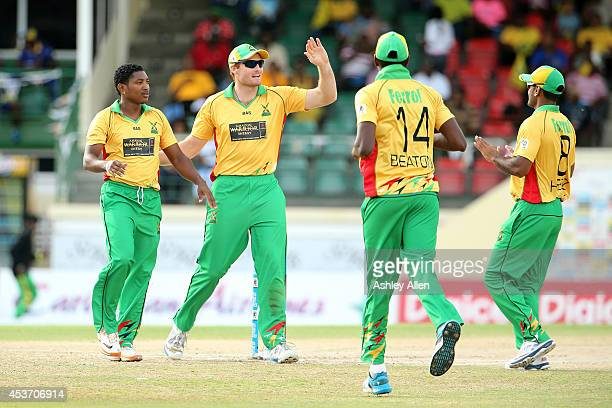 Players of Guyana Amazon Warriors celebrate a wicket during the Limacol Caribbean Premier League 2014 final match between Guyana Amazon Warriors and...