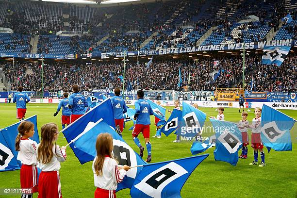 Players of Hamburg run onto the pitch before the Bundesliga match between Hamburger SV and Borussia Dortmund at Volksparkstadion on November 5 2016...