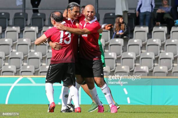Players of Hannover 96 celebrate after winning the half final match between SpVg Blau Weiss 1890 and Hannover 96 during the DFB over 40 and 50 cup at...