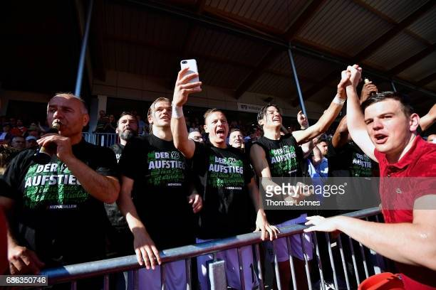 Players of Hannover 96 celebrate with the fans after the Second Bundesliga match between SV Sandhausen and Hannover 96 at Hardtwaldstadion on May 21...